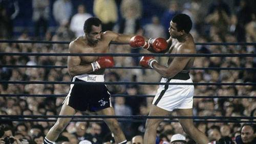 Muhammad Ali (right) backs out of the way of a punch from Ken Norton during a heavyweight fight on Sept. 28, 1976 at Yankee Stadium. (Photo by Focus on Sport/Getty Images)